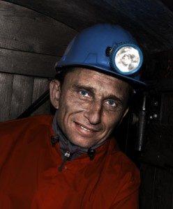 Coal miner wearing helmet with light