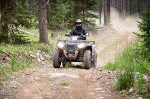 Riding ATV on dirt road